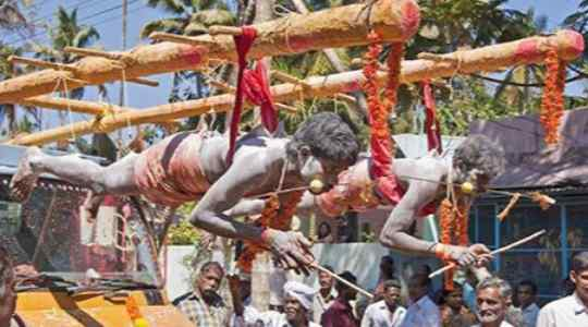 PAINFUL RITUAL! Watch Indians Hang Themselves With Rods To Serve Their Goddess 15