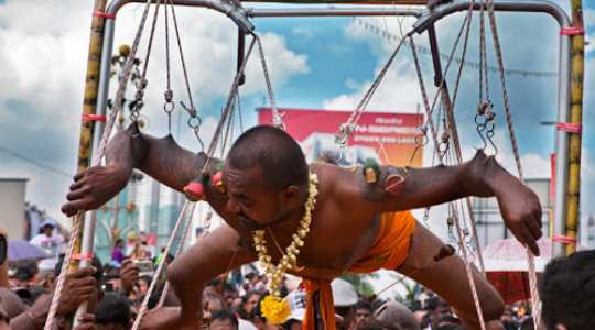 PAINFUL RITUAL! Watch Indians Hang Themselves With Rods To Serve Their Goddess 12