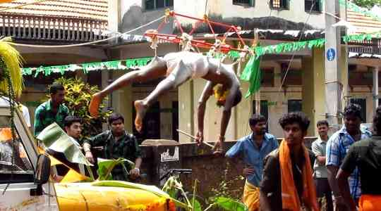 PAINFUL RITUAL! Watch Indians Hang Themselves With Rods To Serve Their Goddess 16